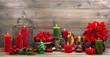Obrazy na płótnie, fototapety, zdjęcia, fotoobrazy drukowane : vintage christmas decorations with red flower poinsettia