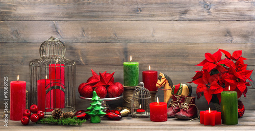 Fototapeta vintage christmas decorations with red flower poinsettia