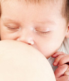 Close-up portrait. Young mother breastfeeds her baby. Breast-fee poster