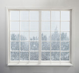Fototapety Modern residential window with snow and trees