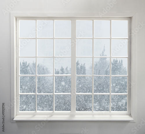 Modern residential window with snow and trees - 91929796