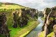 Beautiful Fjadrargljufur canyon with river and big rocks