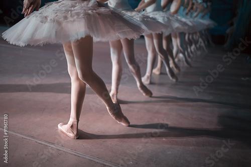 Naklejka Dancers in white tutu synchronized dancing
