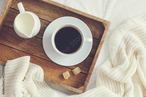 Poster cup of coffee, cream and brown sugar on wooden tray