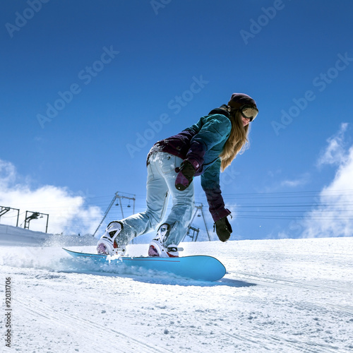 Snowboarder moving down Poster