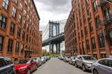 New York City Manhattan Bridge and brick wall building