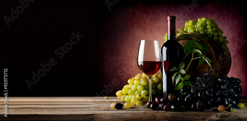 Vine of grape with wine Poster