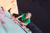 Aged Woman Climbing Wall Elderly Female Demonstrates Excellent Physical and Moral Abilities Ascending Vertical Climbing Wall
