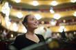 Girl in auditorium of teatre