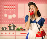 Retro woman talking on phone in her kitchen interior poster