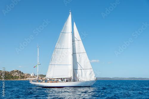 Elegant old italian style sailboat, on a wonderful blue sea, Sardinia, Italy Poster