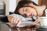 Fototapety Tired overworked woman resting while writing notes