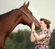Obrazy na płótnie, fototapety, zdjęcia, fotoobrazy drukowane : Beautiful girl talking with her free horse