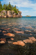 A scenic black sand and pink granite beach on the North Shore of