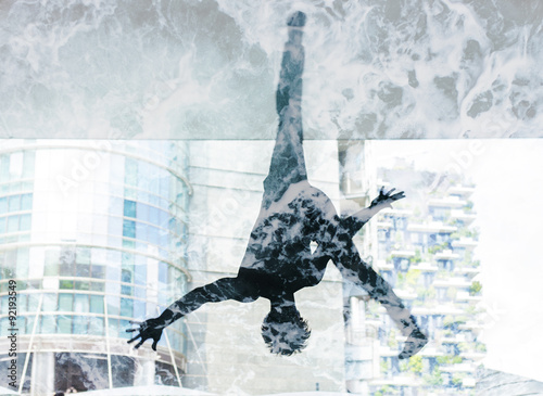 Double exposure of dancer silhouette and sea foam texture - 92193549