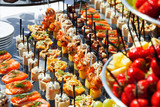 Fototapety meat, fish, vegetable canapés on a festive wedding table outdoor