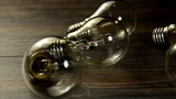 Many bulb and lights up only one. The concept of idea. The flashing bulb light Spoiled poster