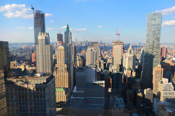 New York City aerial panorama view with skyscrapers and blue sky during the day