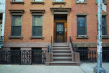 Fototapety Brownstone brick wall house