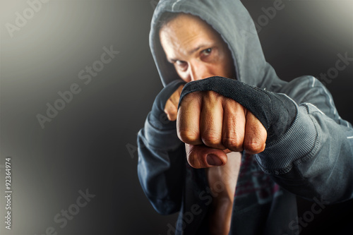 Staande foto fist of young dangerous man closeup