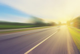 Empty asphalt road in motion blur and sunlight with vintage tone - Fine Art prints