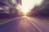 Fototapety Empty asphalt road in motion blur and sunlight with vintage tone