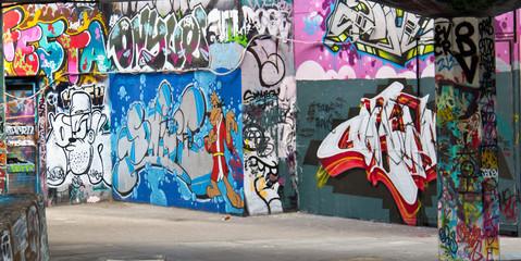 Graffiti spray paint art on a wall in a public space
