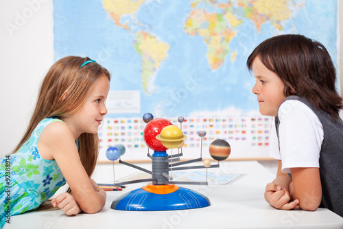 Poster Kids with a scale model planetary system in science class