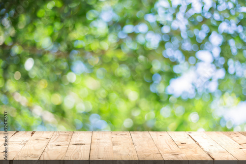 wood table perspective and green leaf bokeh blurred for natural - 92410357