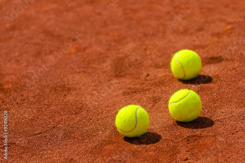 Fotobehang Tennis Tennis balls on clay court