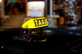 Fototapety Taxi sign at night