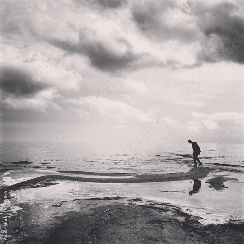 Foto op Aluminium Exclusieve a man on the coast