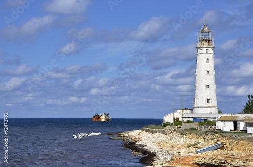 Fotobehang Vuurtoren / Mill Old lighthouse on the beach