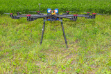 Multicopter standing on the ground poster
