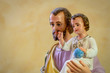 Classical church statue of baby Jesus held by St Joseph