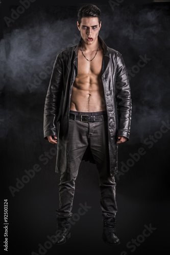 Young Vampire Man in an Open Black Leather Jacket, Showing his Poster