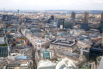 LONDON, UK - SEPTEMBER 17, 2015: City of London aerial view, office buildings and streets. London panorama form 32 floor of Walkie-Talkie building