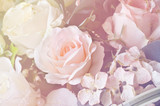 Fototapety Soft focus artificial orange and white rose  flowers bouquet