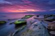 Sea rocks at sunrise. Magnificent sunrise view in the blue hour at the Black sea coast, Bulgaria