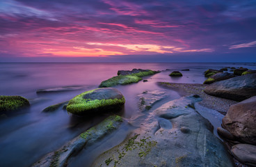 Sea rocks at sunrise. Magnificent sunrise view in the blue hour at the Black sea coast, Bulgaria