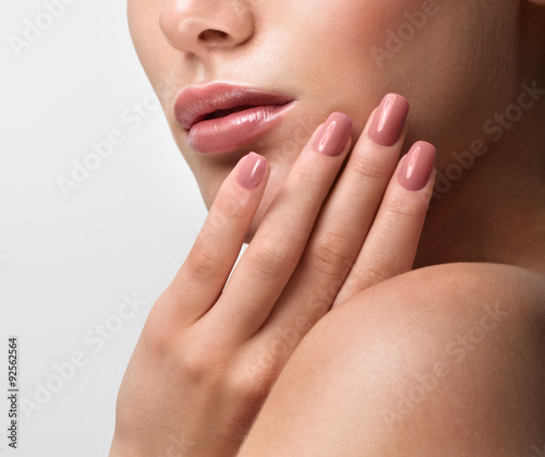 Foto op Canvas Manicure Beautiful Young Woman with Clean Fresh Skin. Close up Portrait.