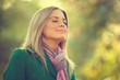 Young woman enjoying fresh air in autumn, intentionally toned.