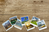 Fototapety snapshots of travel destinations on wooden background