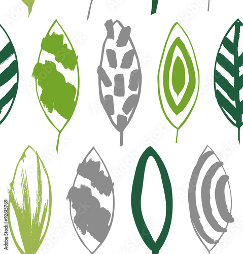 Seamless decorative green pattern with ink drawn leaves. Vector texture in grunge style © silmen