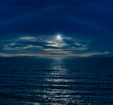Fototapety Night sky with full moon and reflection in sea and clouds