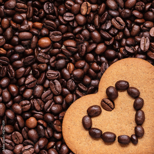 Heart shaped cookie on coffee beans background