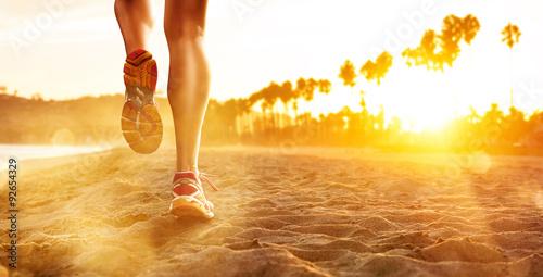 Fototapeta Running at the Beach