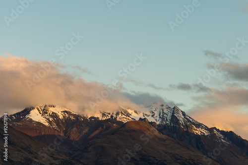 alpine landscape with snow and cloud on top - 92671194