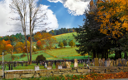 Old graveyard in an autumn landscape with fall colors. Location: Vermont