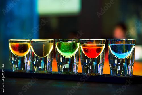 Fototapeta Colorful shot drinks in nightclub